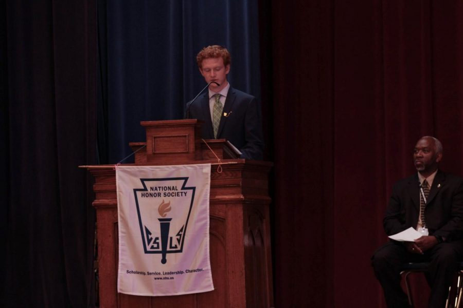 President of NHS, Aidan Sheridan-Rabideau inducts new members into the honor society. Photo courtesy by Christeen Florence.