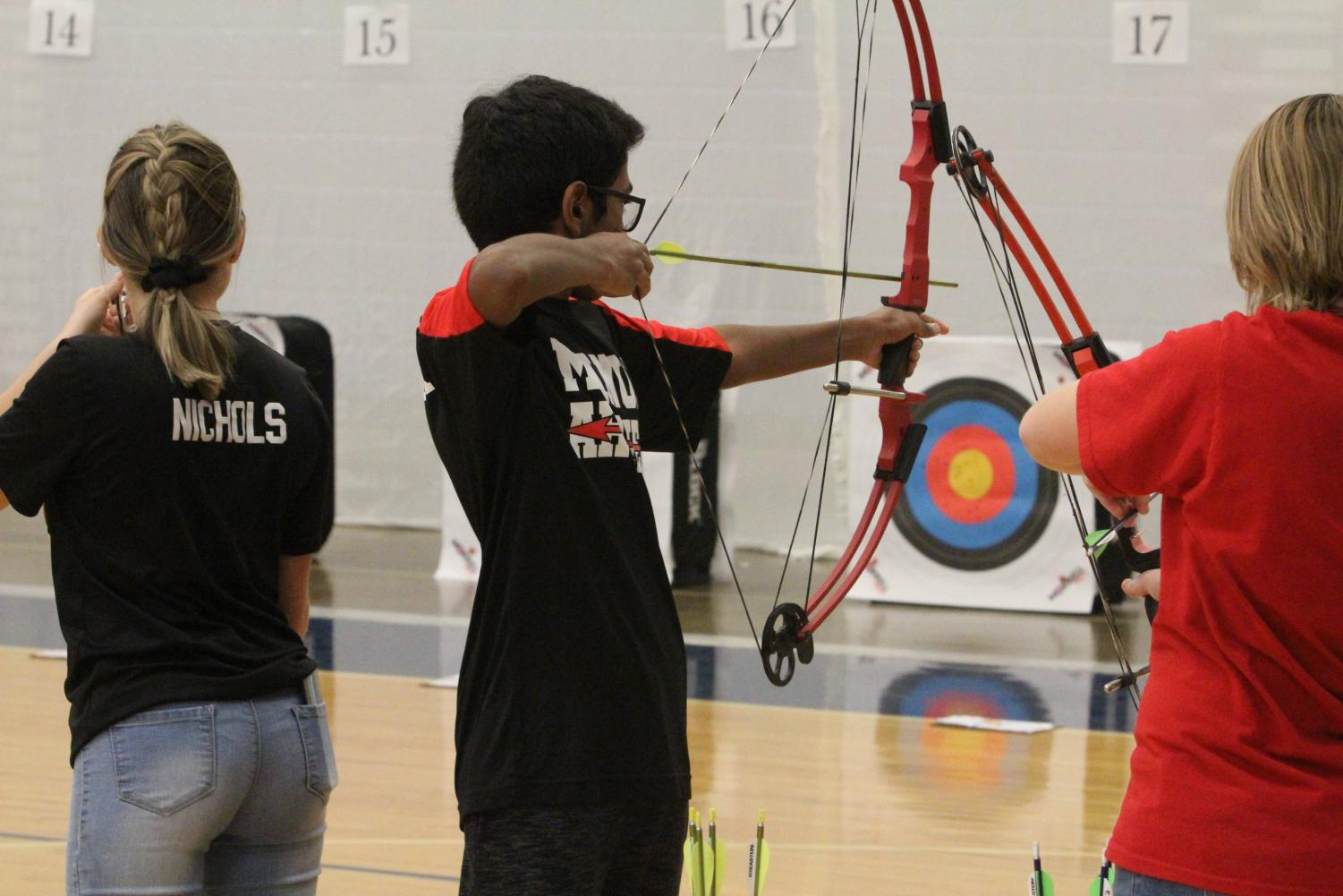 Manual's archery team competes against Eastern. Photo by Satchel Walton.