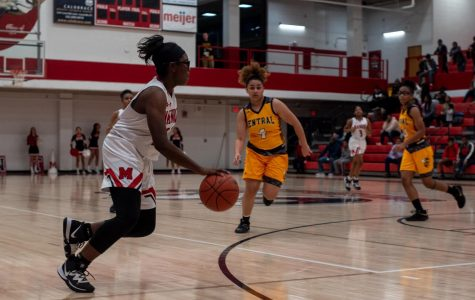 Ayanna Stroud (10, HSU) dribbles past a Central player. Photo by Cesca Campisano.