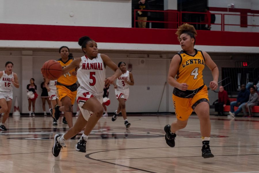 Sydne Tolbert (9) dribbles past a Cental player during the homecoming game.  Photo by Cesca Campisano.