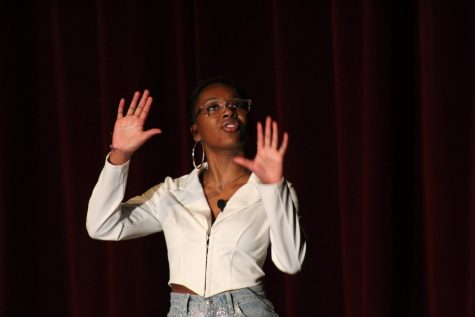 "Faith Lindsey (11, J&C) performs the poem ""Still I Rise"" by Maya Angelou. Photo by Molly Gregory."
