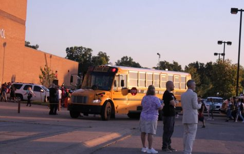 On Aug. 15 2019, administrators watch buses arrive to school in the morning. JCPS's busing policy, implemented in the school year of 1975-1976, provides busing for any students living more than a mile away from their school. This practice attempted to desegregate the city.