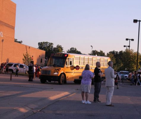 On Aug. 15 2019, administrators watch buses arrive to school in the morning. JCPS