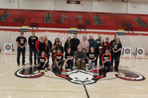 The six seniors from the archery team and their families and coaches lined up for senior night. Photo by Anna Schroll.