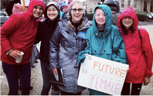 Suzanne Kugler and some students at the Women's March in Louisville. Photo Courtesy by Suzanne Kugler