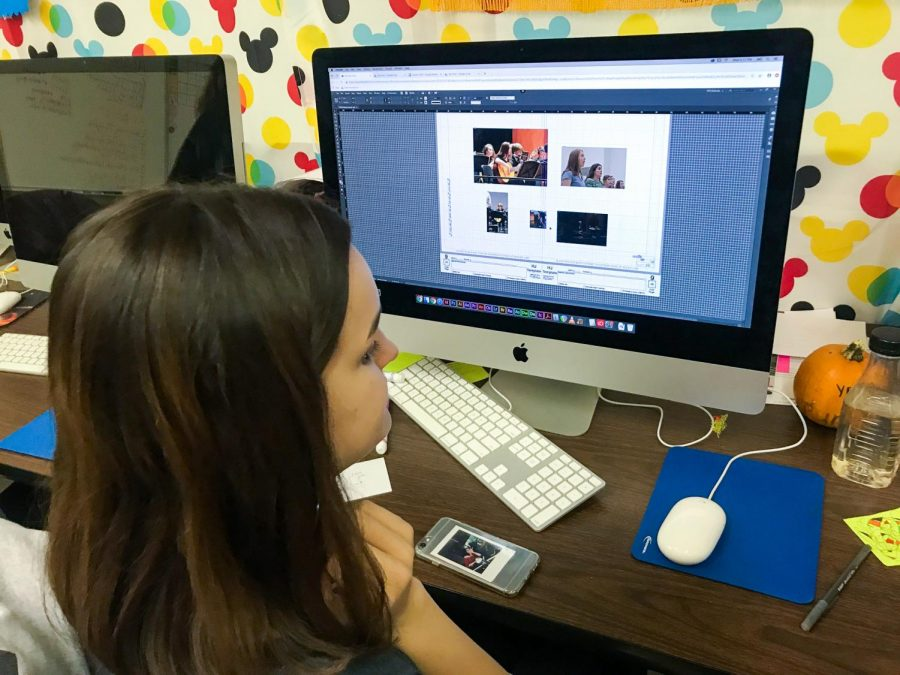 Destiny Graham (12, J&C) begins designing a divider for the 2019-2020 yearbook. Photo by Addison Falkner.