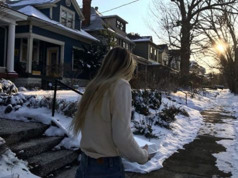 Olivia Brotzge (11, J&C) spends time with a new friend in the cold temperatures. Photo courtesy of @drizzy.liv via Instagram.