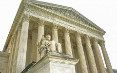 Photo of the Supreme Court building showing the Contemplation of Justice.