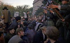 National guardsmen and protestors face off in Washington DC during 1967 Vietnam war protests.