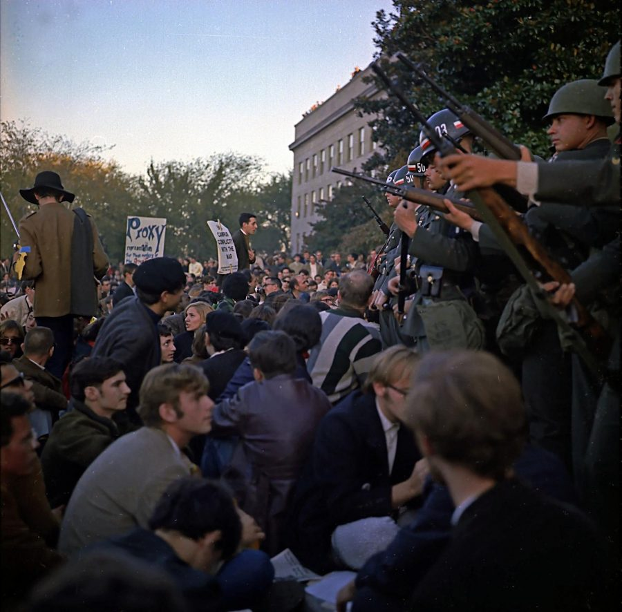 National guardsmen and protestors face off in Washington DC during 1967 Vietnam war protests.