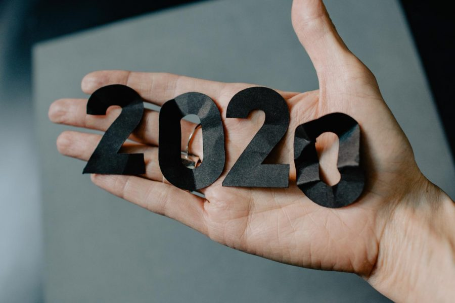 Someone+holds+crumpled+paper+cut+into+the+numbers+2020.+Photo+by+Kelly+Sikkema.+Sourced+from+unsplash.com.