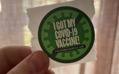 A vaccination sticker that is received after the first dose. Photo by EP Presnell.