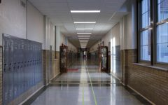 Tape outlines left and right lanes in order to maintain social distancing in the hallways.