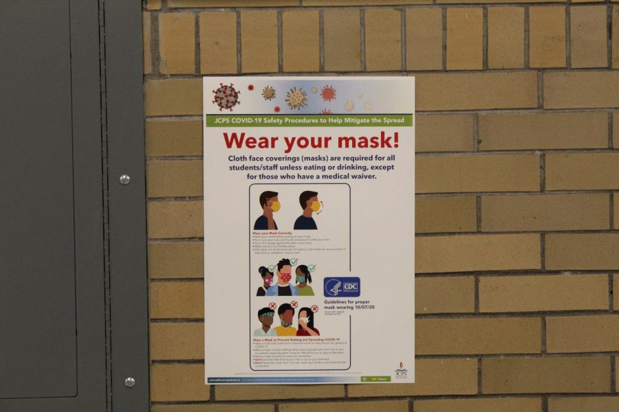 COVID-19+protocol+posters+hang+in+the+hallways+by+bathrooms%2C+encouraging+people+to+wear+their+masks.