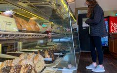 Emerson Jones (9, J&C) order a bagel for lunch at BreadWorks. Photo by Mya Cummins
