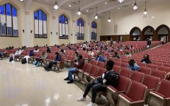 Students waiting in the auditorium before their first block class on the first day of school.
