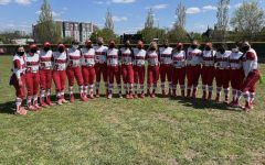Photo of the softball team prior to a game at Rachel Baker Field. Photo courtesy of the softball team.