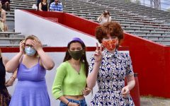 Seniors Claire Rooney (J&C), Marilyn Buente (J&C) and Lillian Metzmeier (J&C) pose outside of the bleachers at Manual Stadium.