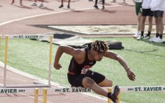 Darius Brown in stride over a hurdle at St. Xavier Master meet. Photo courtesy Darius Brown