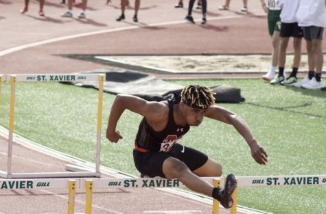 Darius Brown in stride over a hurdle at St. Xavier Master meet. Photo courtesy Darius Brown