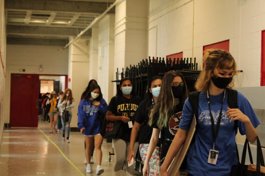 Seniors begin their final walkthrough of the building. Photo by Molly Gregory.