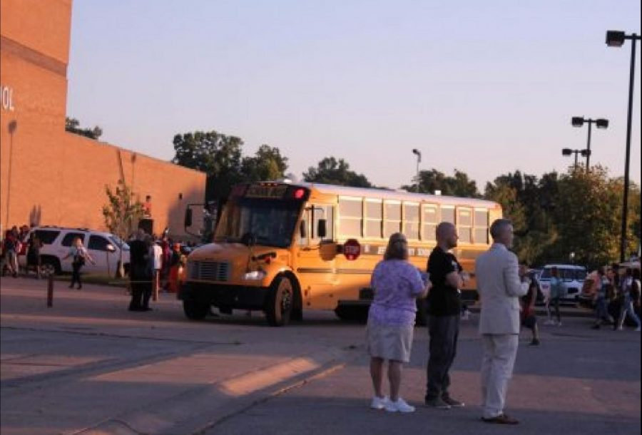 On Aug. 15 2019, administrators watch buses arrive to school in the morning. JCPSs busing policy, implemented in the school year of 1975-1976, provides busing for any students living more than a mile away from their school. This practice attempted to desegregate the city. Photo by Mandala Gupta-VerWiebe.