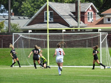 Manual girls pressure St. Henry goalie Savannah Wood (12, #0) after an attempted shot by Manuals Amelia Jones (10, #23). Photo by Yaara Aleissa.