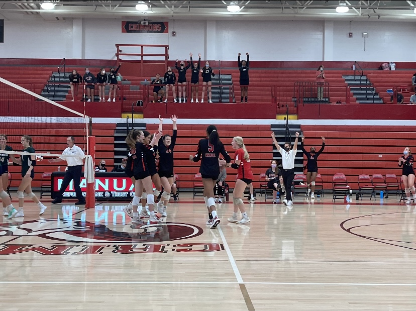 Manual's volleyball team after winning the fourth set and defeating South Oldham. Photo by KC Ciresi.