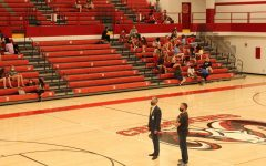 Mr. Kuhn and Mr. K stand watch over the auditorium on the day of the senior walk. Photo by Molly Gregory.