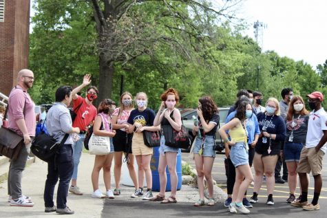 A group of J&C students from the class of 2021 stand in the parking lot after their final walk through the building. Photo by Molly Gregory.