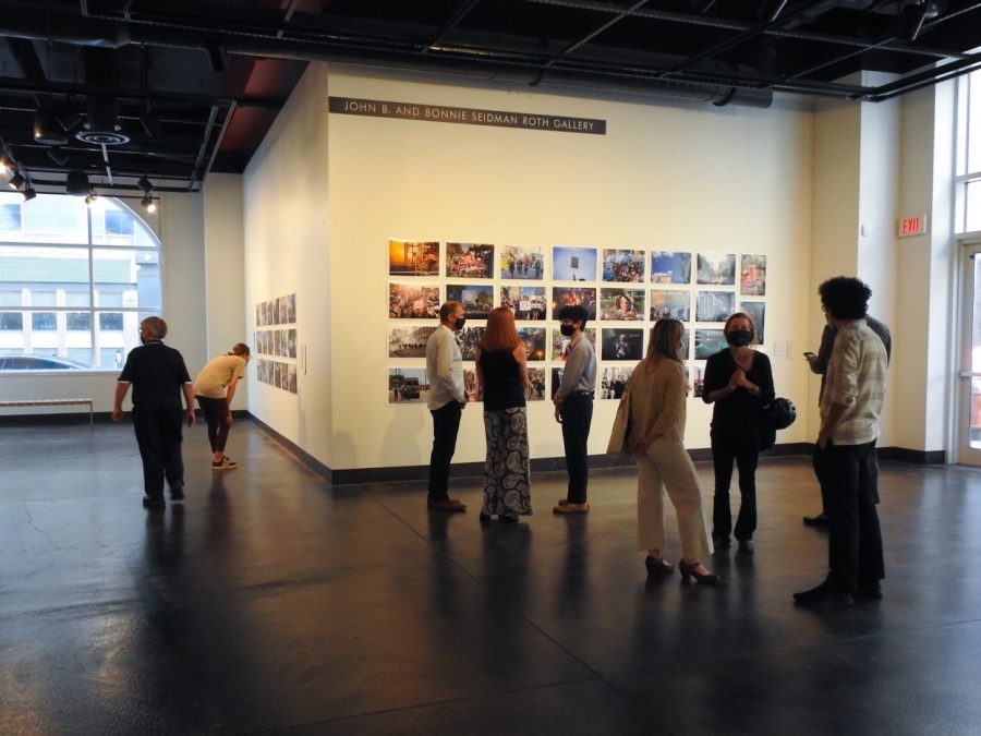 Guests at the Cressman Center for Visual Arts mingle and look at the photos in the gallery. Photo by Isaac Barnett.