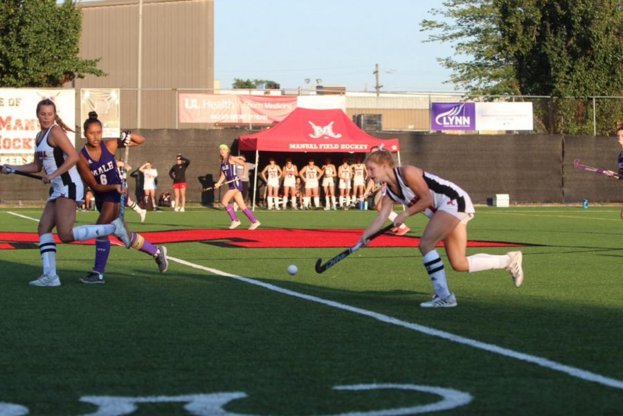 Amelia Frey (right) dribbles down the field, ready to pass to Anna Claire Straub (left). Photo by Caroline Toler.