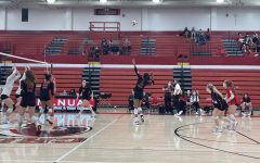 Nya Bunton (#5, 11) goes up for a back row kill and takes the point for Manual.