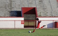 Shoma Lowber (12, HSU) prepares to strike a cross in a game during his sophomore year.